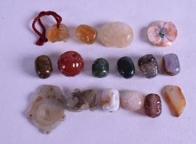 A GROUP OF VARIOUS CHINESE CARVED HARDSTONE AMULETS in