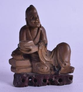 A 19TH CENTURY CHINESE CARVED SOAPSTONE FIGURE OF A