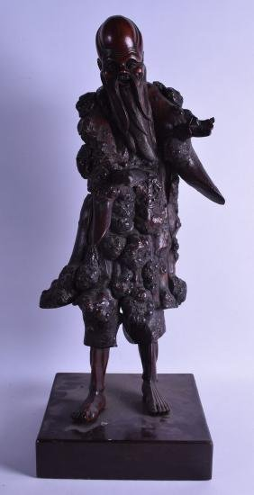 A LARGE 19TH CENTURY CHINESE CARVED ROOTWOOD FIGURE OF