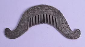 AN EARLY 20TH CENTURY CHINESE SILVERED BRONZE COMB