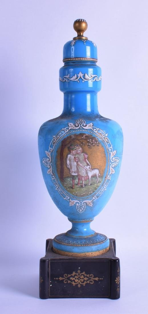 A VICTORIAN BLUE OPALINE GLASS VASE AND COVER painted