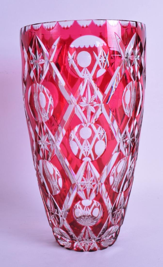 A BOHEMIAN RUBY FLASH CRYSTAL GLASS VASE. 26 cm high.