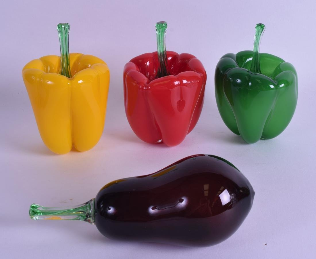 A STYLISH SET OF THREE ART GLASS PEPPERS together with