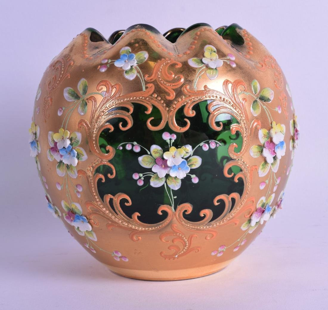 A BOHEMIAN ENAMELLED AND ENCRUSTED GREEN GLASS VASE.