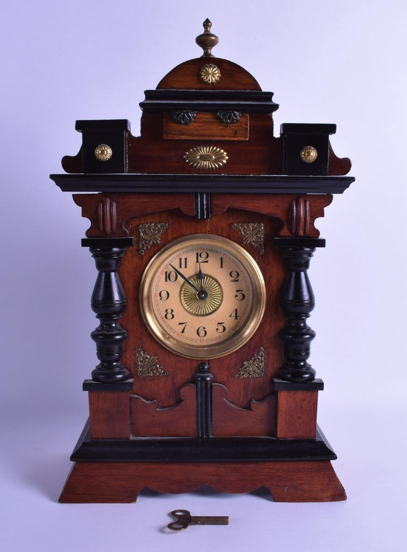 AN EARLY 20TH CENTURY GERMAN POLYPHON ALARM MANTEL