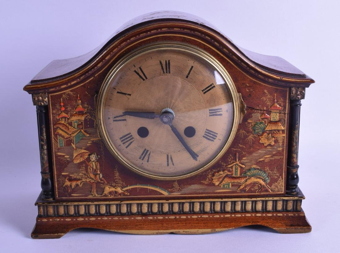 AN EARLY 20TH CENTURY EUROPEAN LACQUERED MANTEL CLOCK