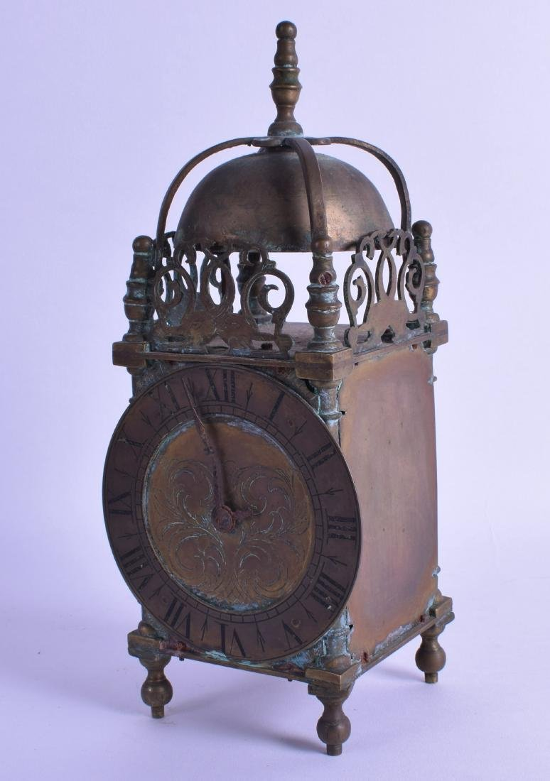 A VICTORIAN BRASS LANTERN CLOCK modelled in the 17th