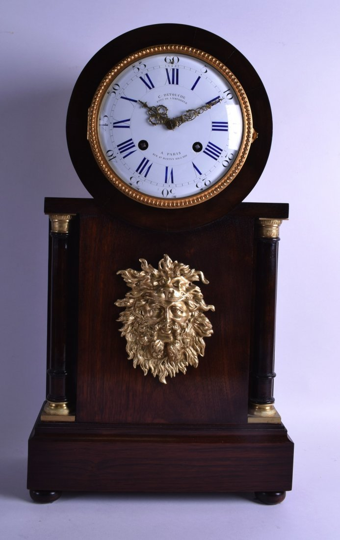 A GOOD FRENCH EMPIRE ROSEWOOD MANTEL CLOCK the dial
