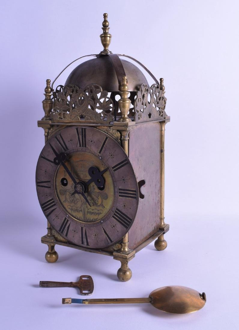 A LARGE ANTIQUE BRASS TWIN FUSEE LANTERN CLOCK the dial