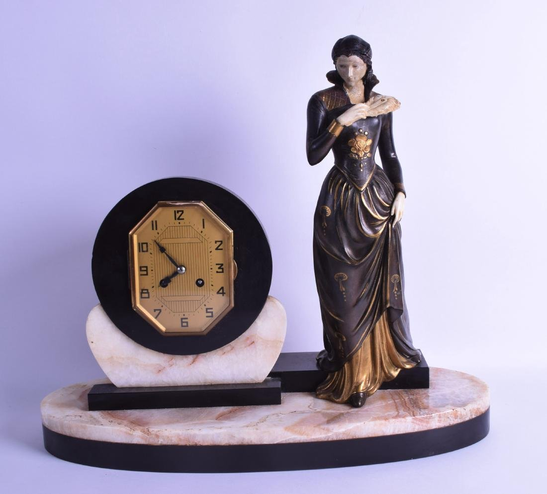 A LARGE ART DECO FRENCH MANTEL CLOCK formed as a