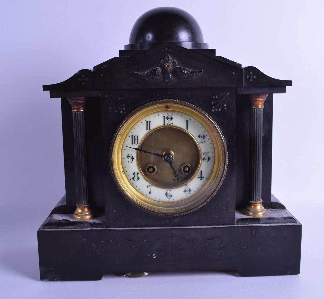 A VICTORIAN BLACK SLATE MANTEL CLOCK decorated with a