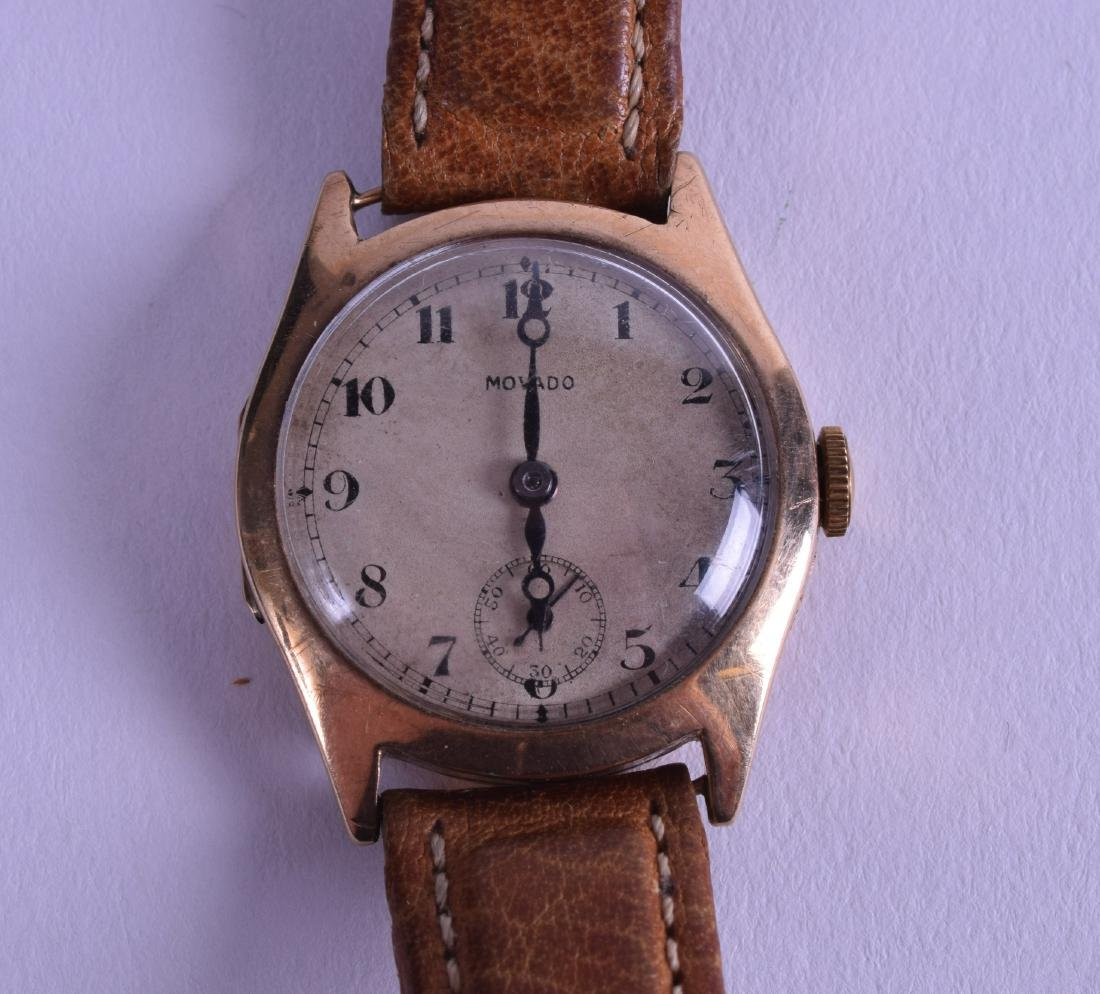 A VINTAGE 9CT GOLD GENTLEMANS MOVADO WRISTWATCH with