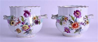 A PAIR OF 19TH CENTURY GERMAN TWIN HANDLED PORCELAIN