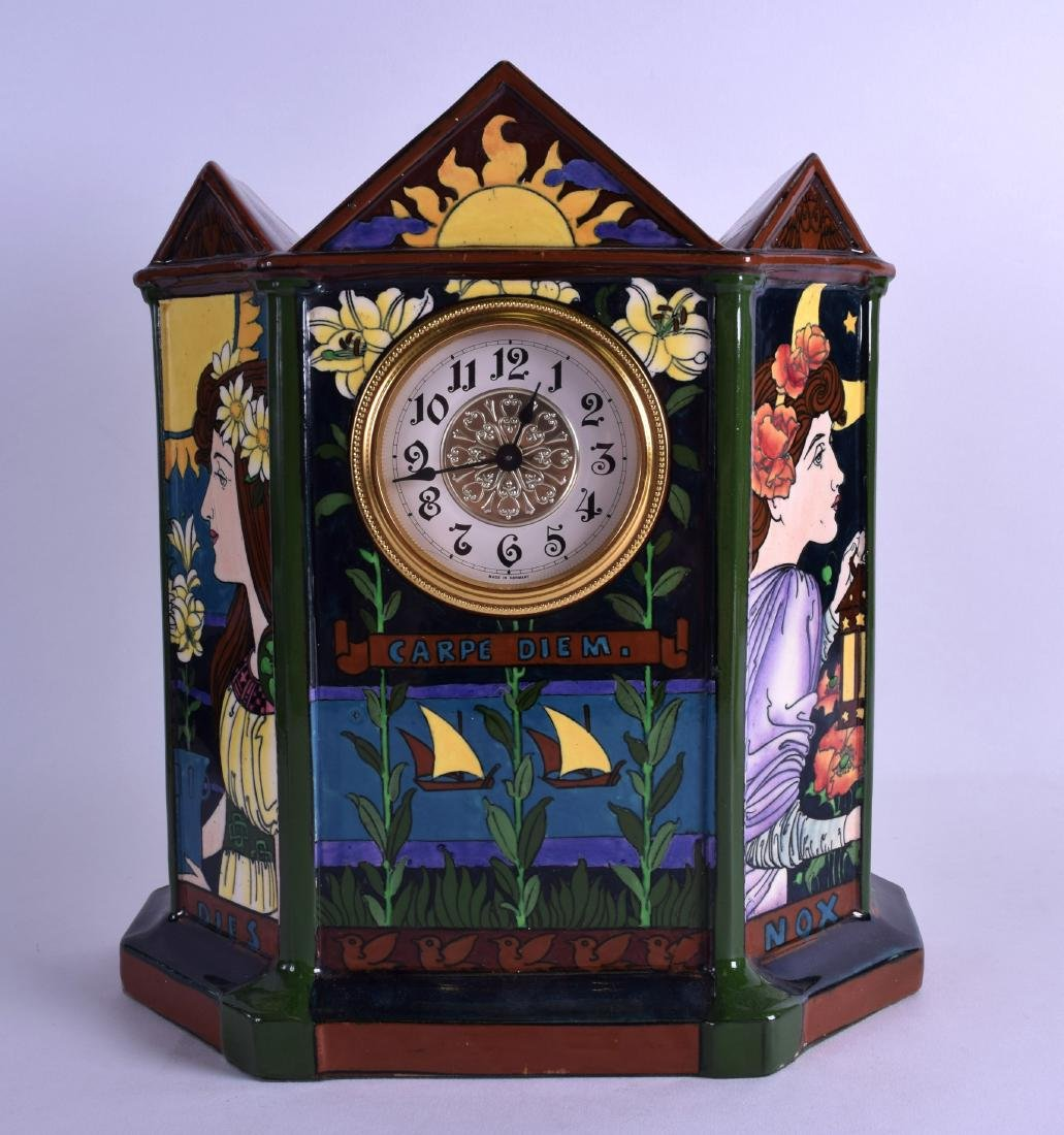 A FOLEY INTARSIO POTTERY MANTEL CLOCK painted with a