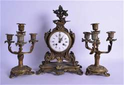 A MID 19TH CENTURY FRENCH GILT BRONZE CLOCK GARNITURE