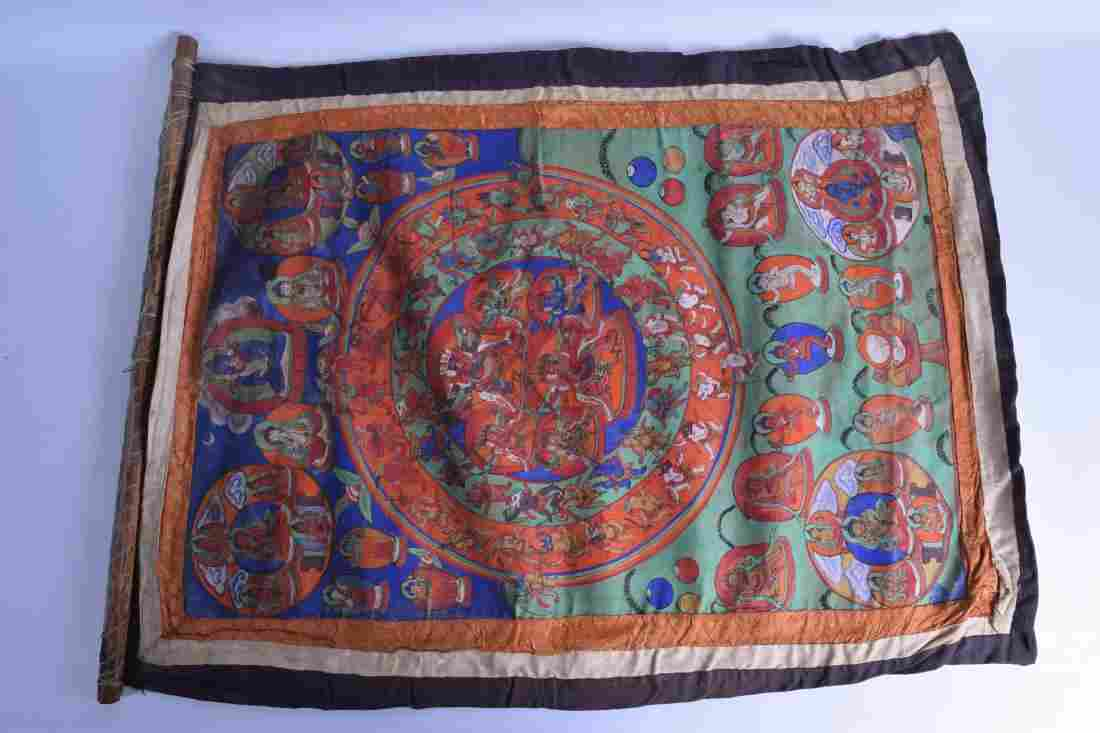 AN ANTIQUE SINO TIBETAN THANGKA painted with buddhistic