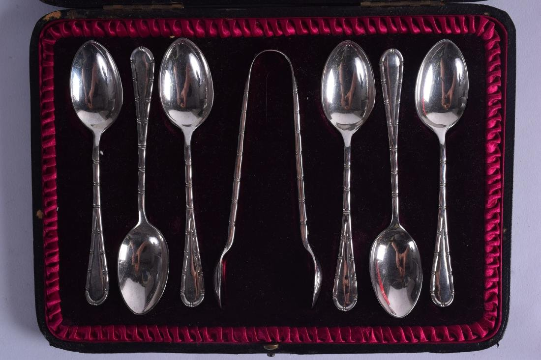 A CASED SET OF SILVER TEASPOONS with matching sugar