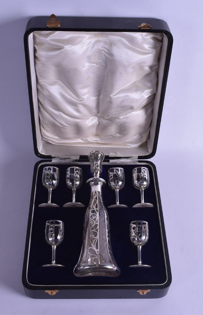 AN ART NOUVEAU SILVER OVERLAID GLASS DECANTER AND