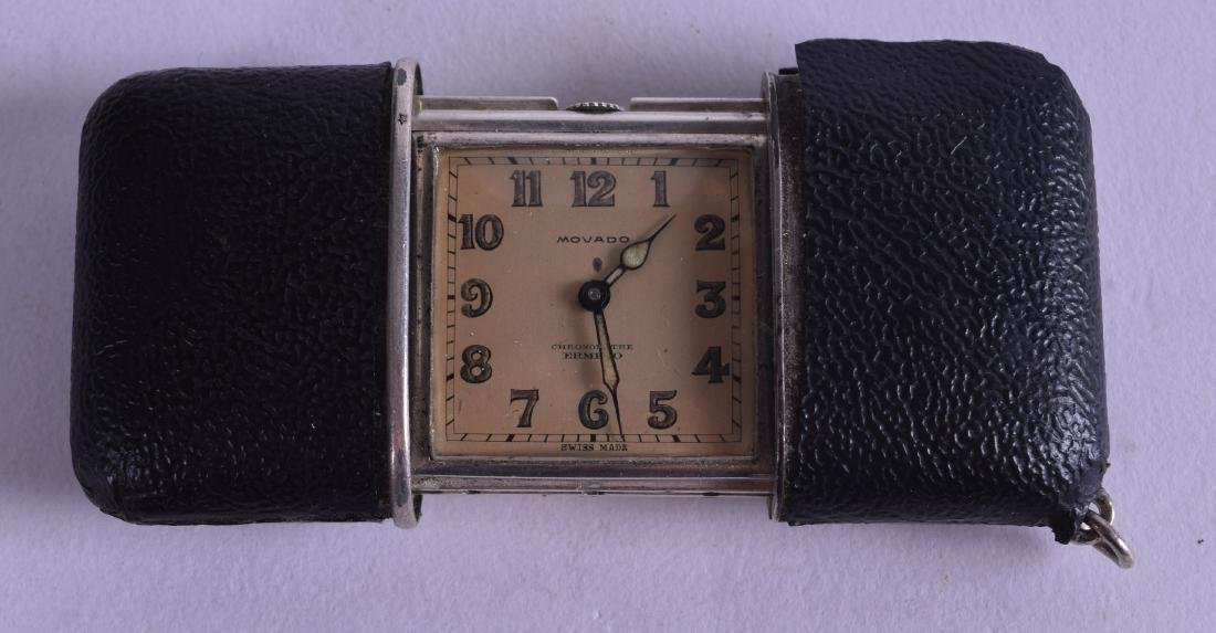A CONTINENTAL SILVER AND LEATHER CASED MOVADO FOLDING