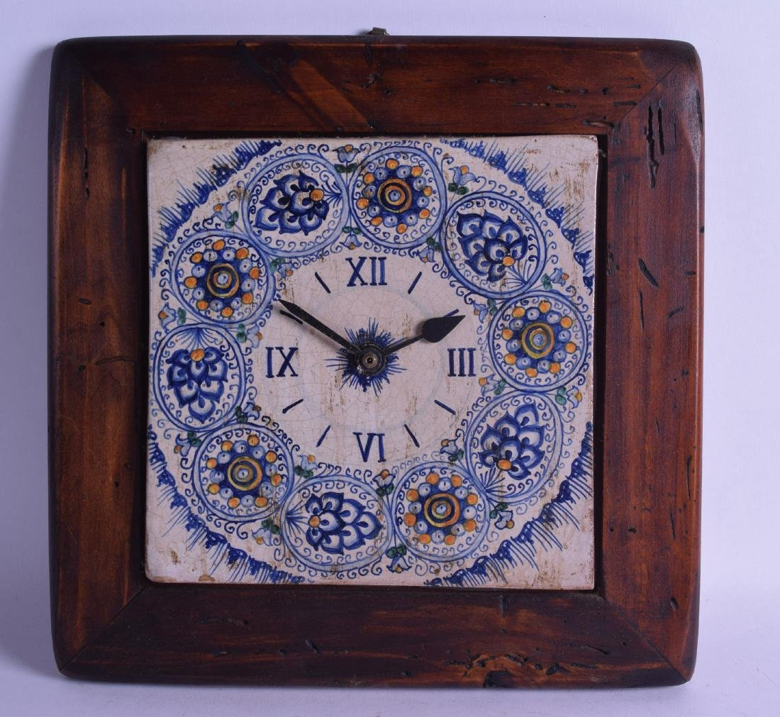 AN UNUSUAL CONTINENTAL FAIENCE POTTERY CLOCK within a