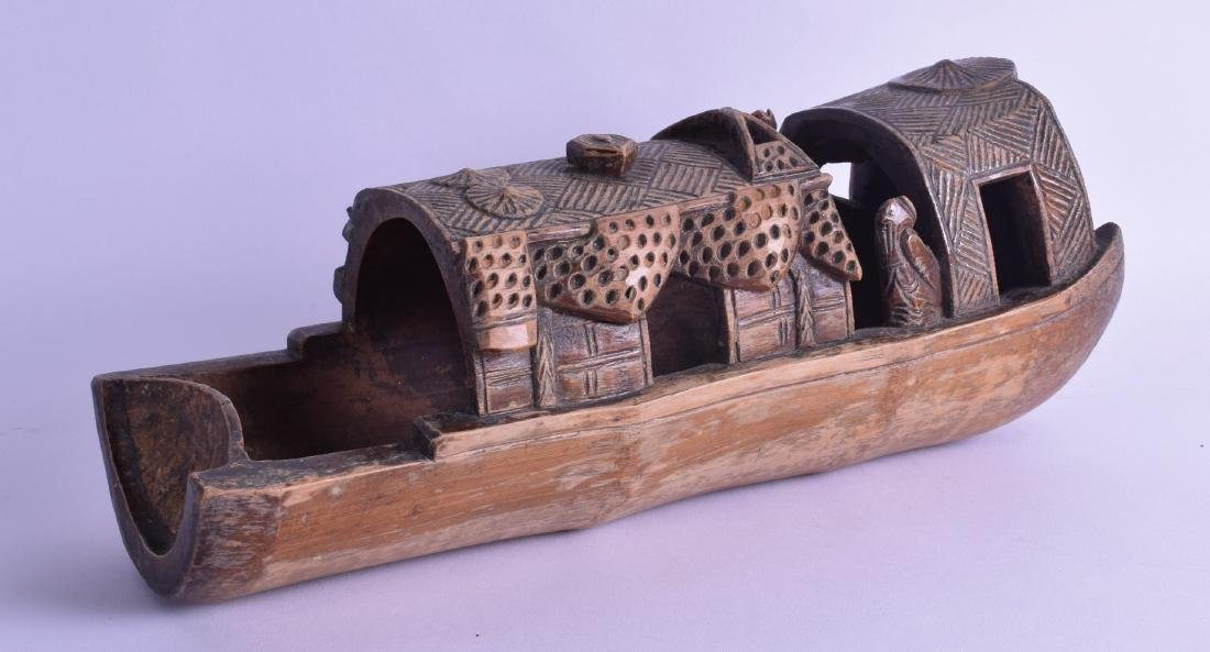 A LATE 19TH CENTURY CHINESE CARVED BAMBOO BOAT modelled