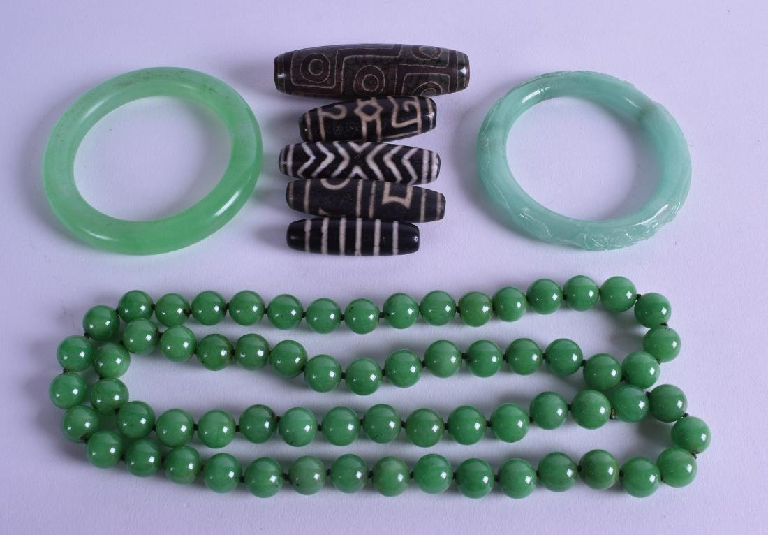 A CHINESE CARVED GREEN HARDSTONE NECKLACE together with