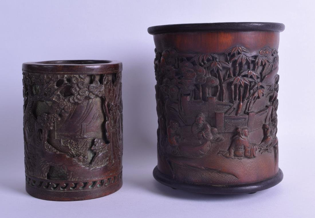 A CHINESE CARVED BAMBOO BRUSH POT decorated with