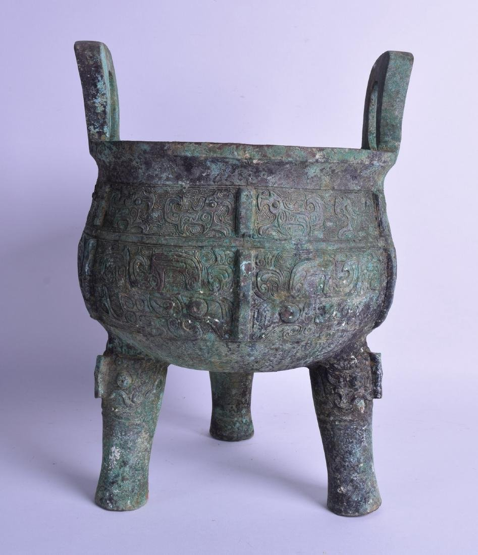 A LARGE CHINESE TWIN HANDLED ARCHAIC BRONZE CENSER