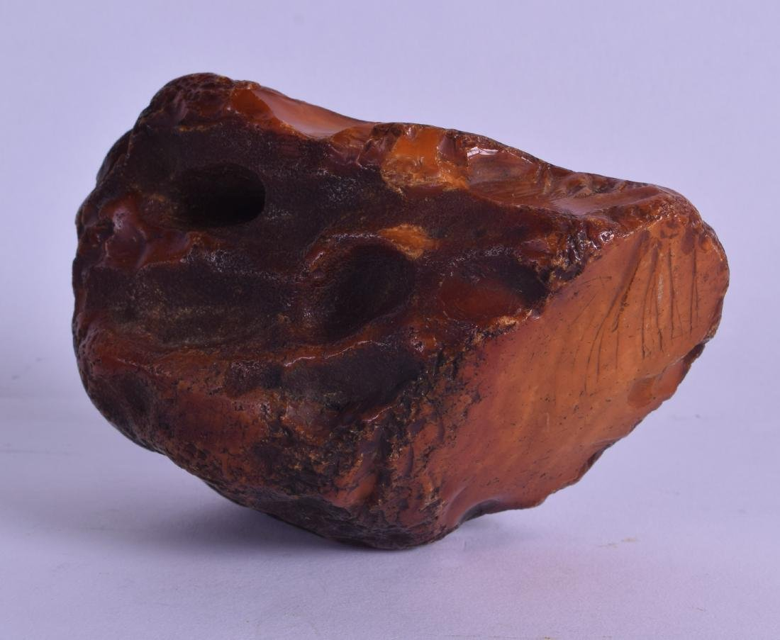 A GOOD CHINESE QING DYNASTY CARVED AMBER SCHOLARS ROCK