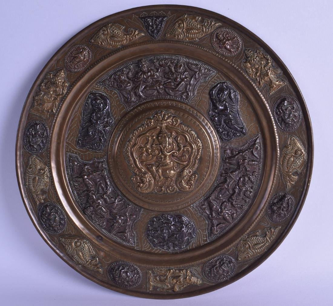 A 19TH CENTURY INDIAN MIXED METAL TEMPLE TRAY decorated