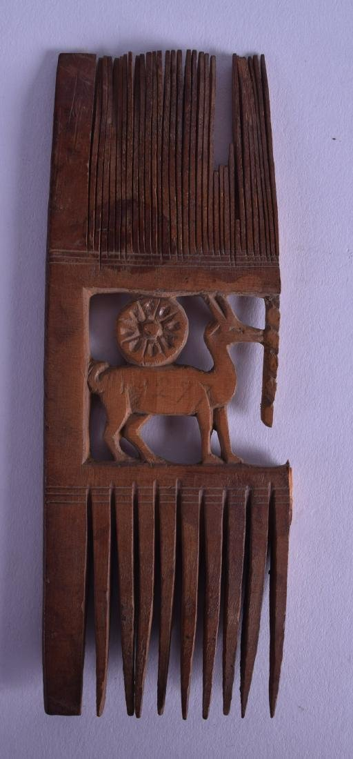 AN EARLY EGYPTIAN CARVED WOODEN COMB formed with a