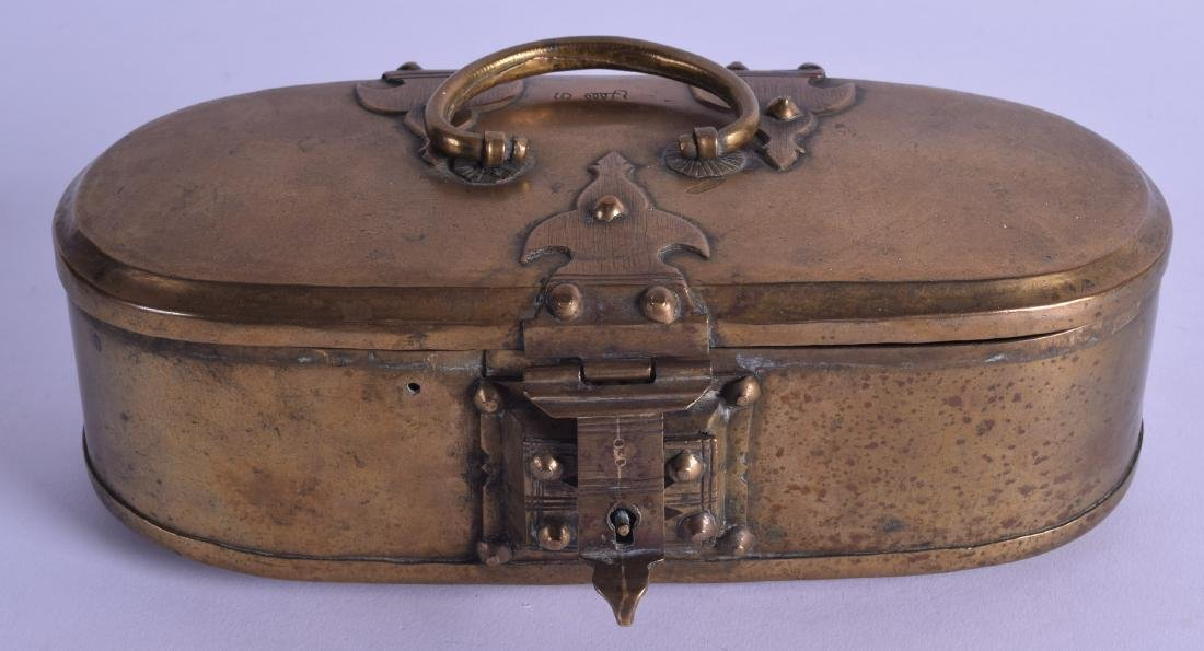 AN 18TH CENTURY ISLAMIC OVAL BRASS TRAVELLING BOX with