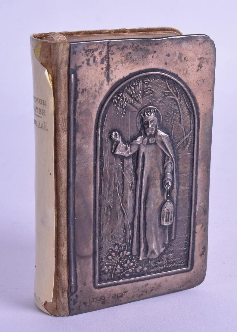 AN UNUSUAL ENGLISH SILVER MOUNTED PRAYER BOOK depicting