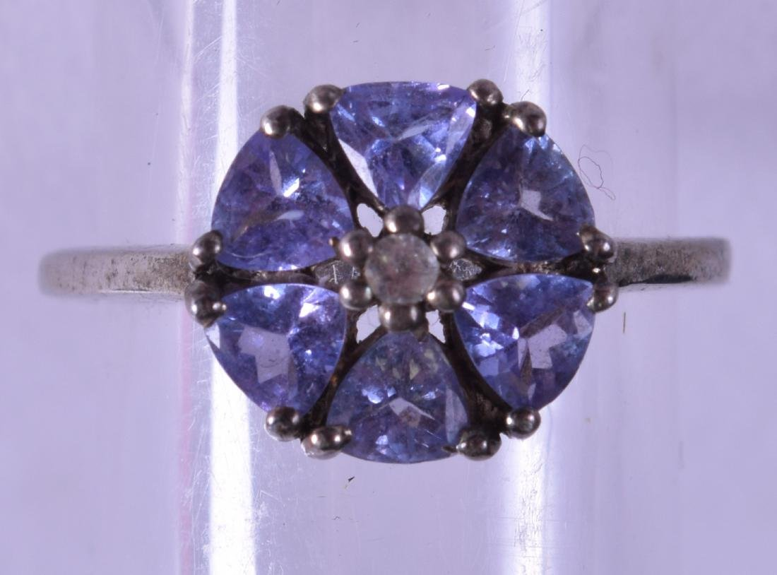 A SILVER AND TANZANITE FANCY RING.
