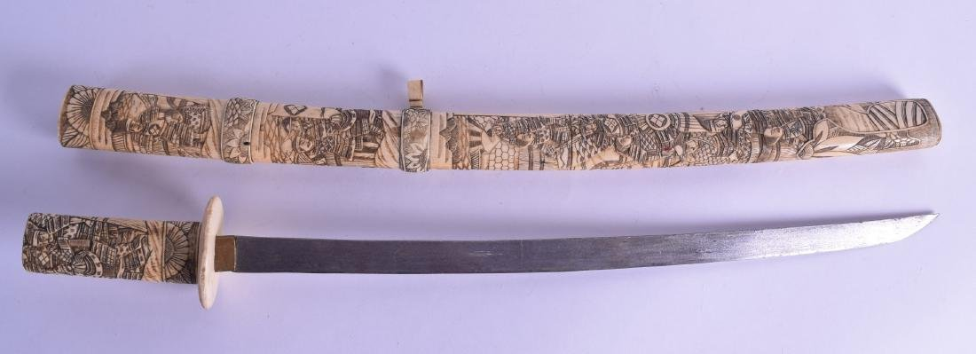 A 19TH CENTURY JAPANESE MEIJI PERIOD CARVED BONE SWORD