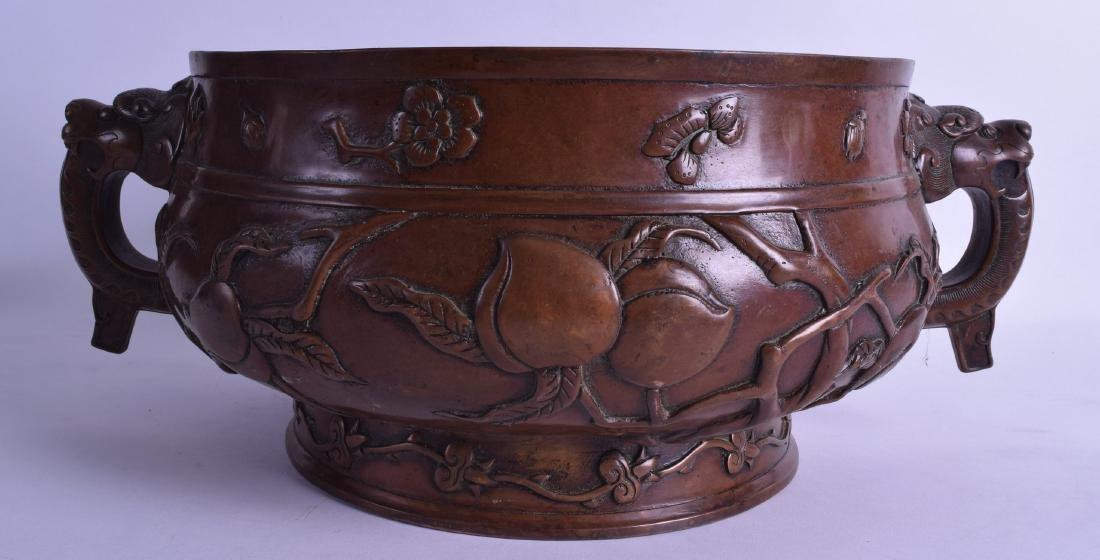 A VERY LARGE CHINESE TWIN HANDLED BRONZE CENSER