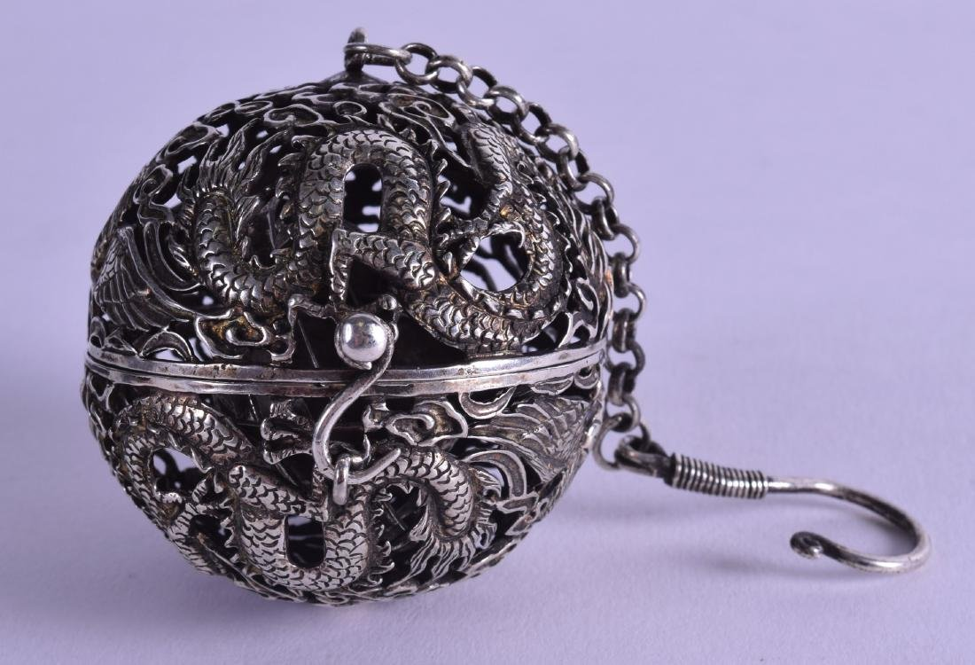 A CHINESE WHITE METAL TRAVELLING OPENWORK CENSER