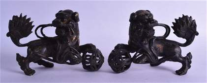 A PAIR OF CHINESE BRONZE FIGURES OF BUDDHISTIC LIONS