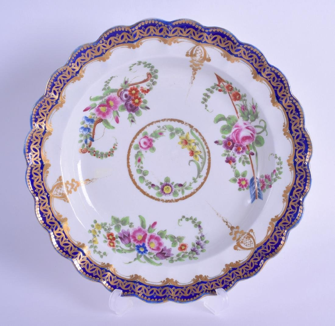 18th c. Worcester plate of fluted shape painted with