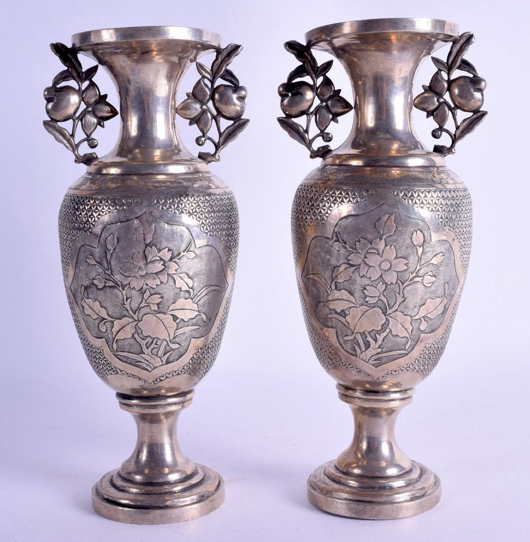 A PAIR OF LATE 19TH CENTURY CHINESE SILVER TWIN HANDLED