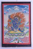 A FRAMED 19TH CENTURY SINO TIBETAN THANGKA painted with