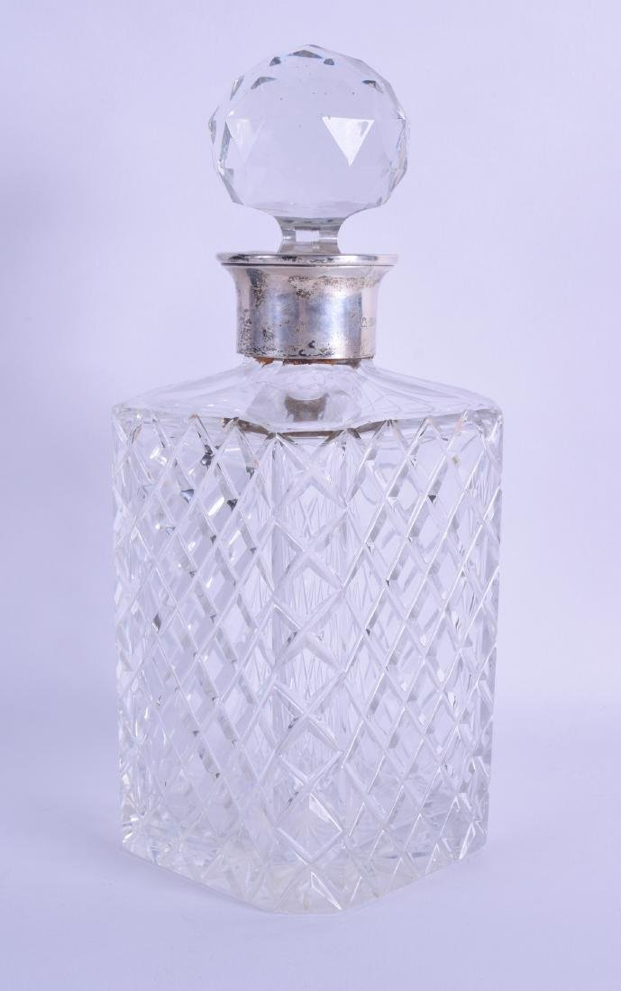 A SILVER MOUNTED ENGLISH DECANTER AND STOPPER with
