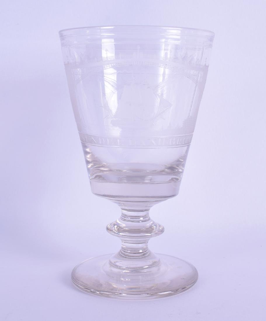 AN ANTIQUE ENGRAVED GLASS BEAKER decorated with a view