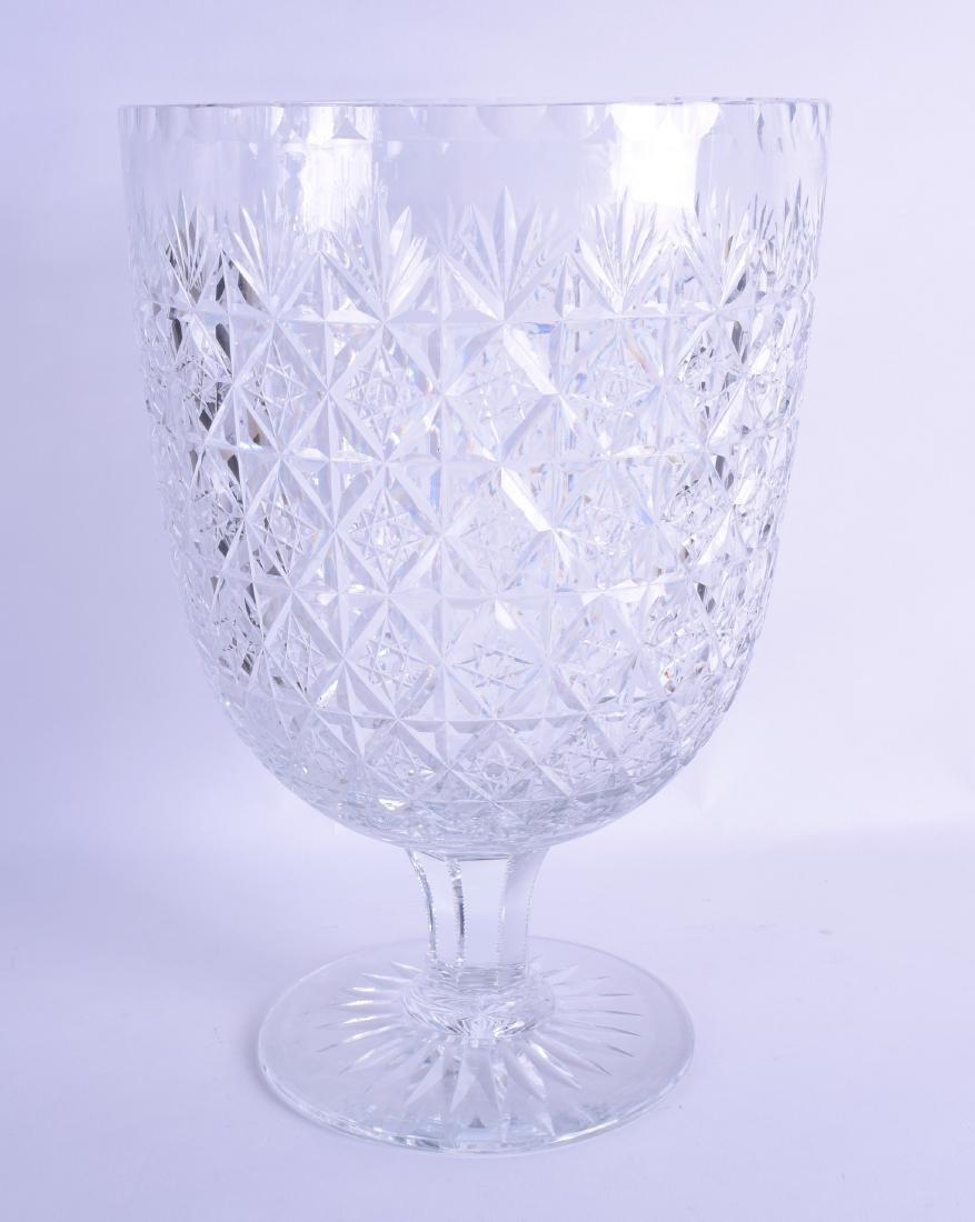 A HUGE CUT GLASS VASE with star cut motifs. 35 cm x 23