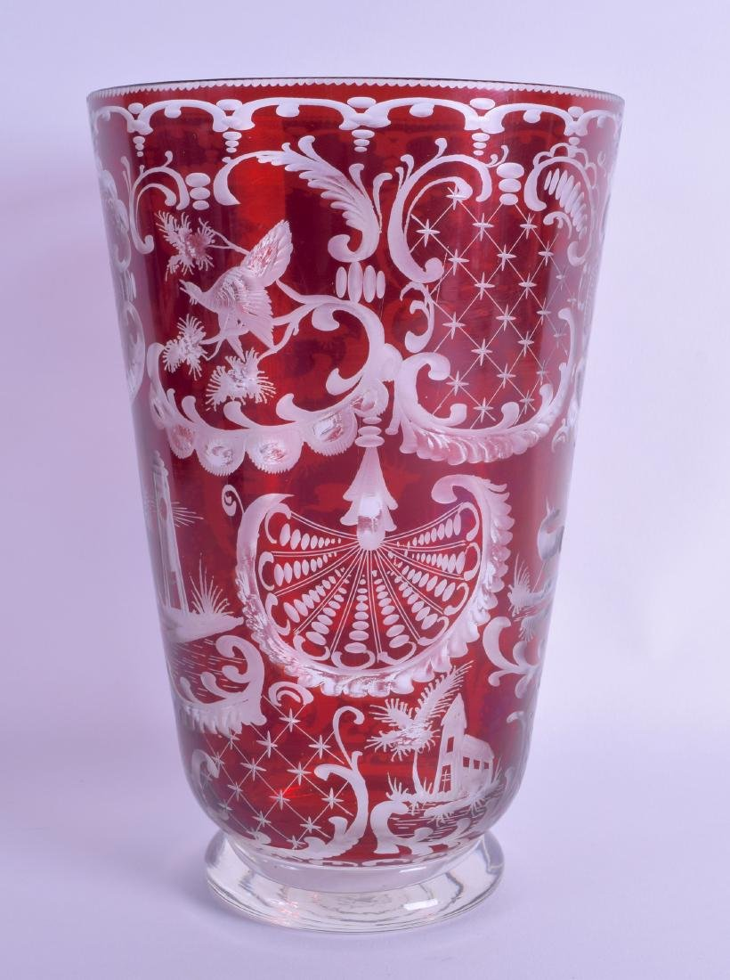 A BOHEMIAN RUBY FLASH GLASS VASE decorated with