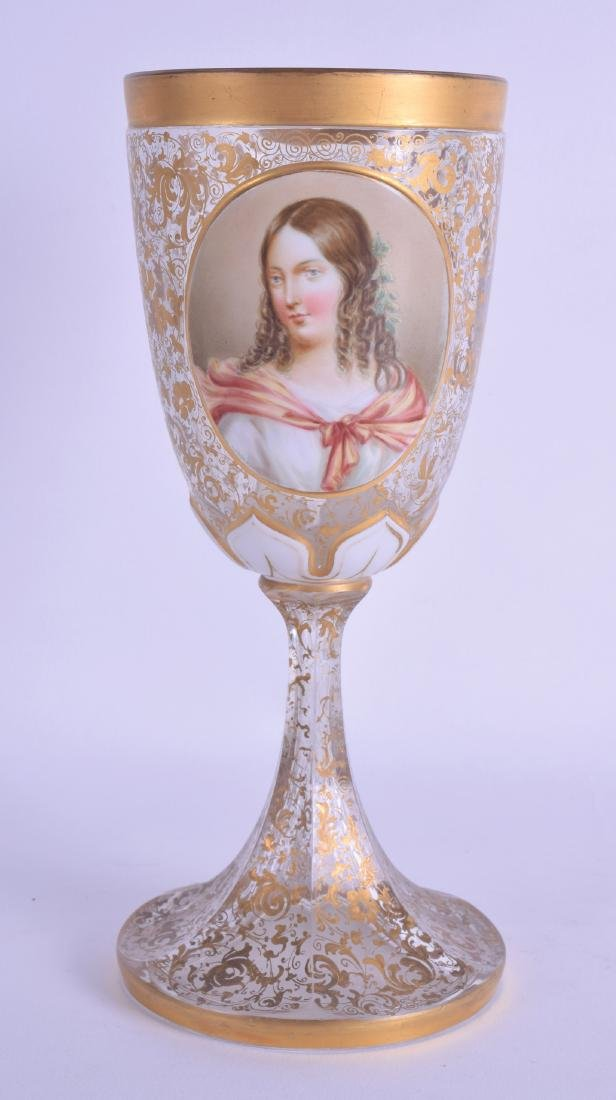 A BOHEMIAN GILT DECORATED GLASS GOBLET painted with a