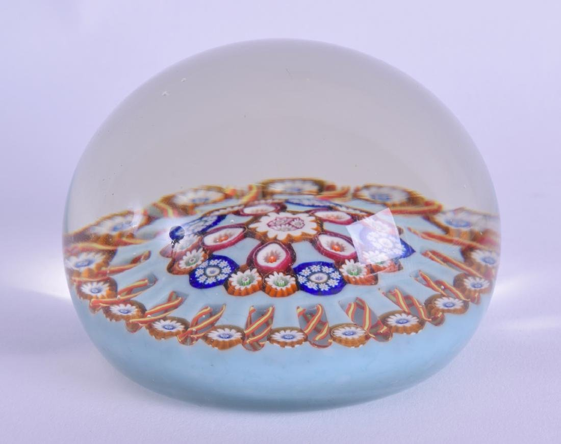 A CONTINENTAL MILLIIFIORE GLASS PAPERWEIGHT decorated