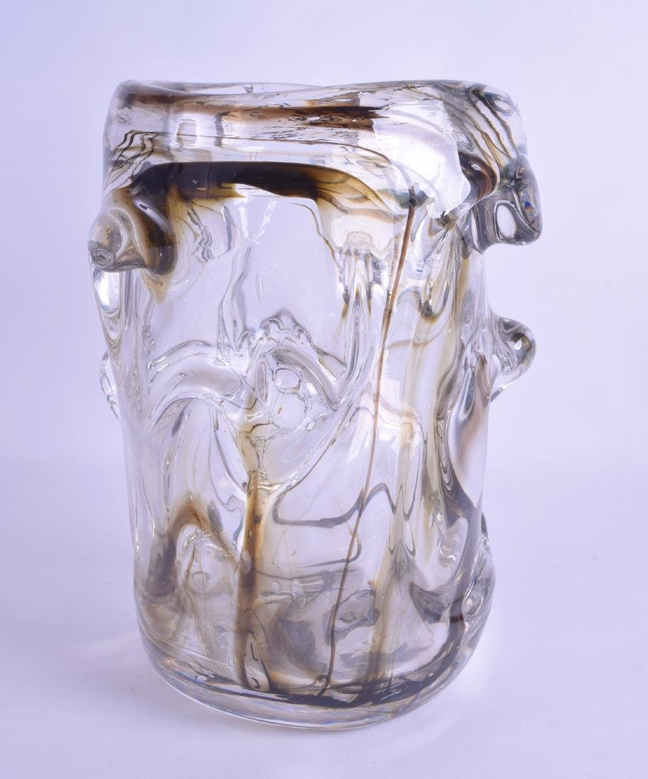 A HEAVY RETRO BLACK AND CLEAR GLASS SWIRLING VASE of