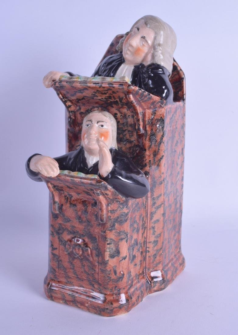 AN EARLY 19TH CENTURY ENGLISH POTTERY FIGURAL GROUP