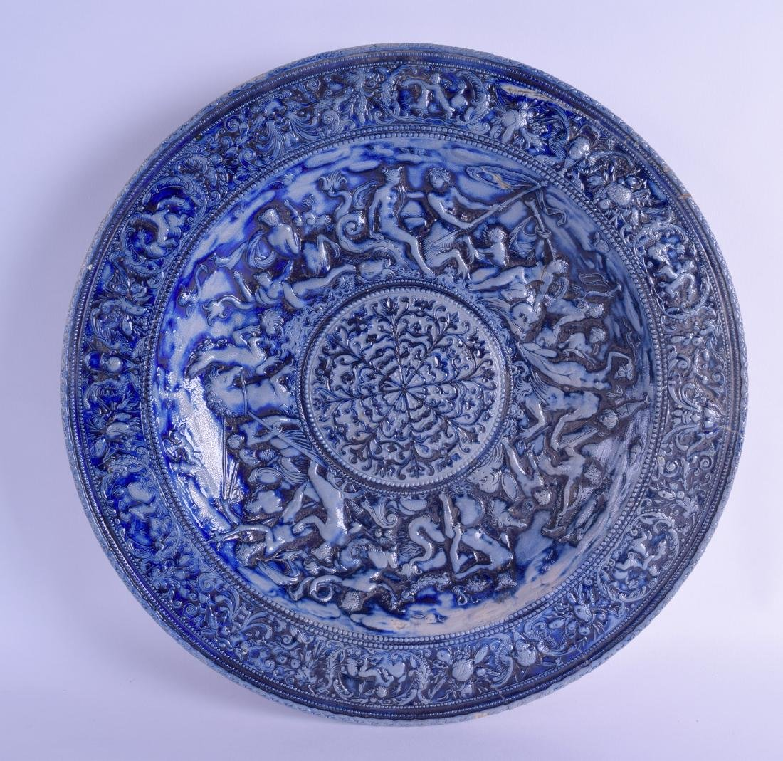 A LARGE GERMAN WESTERWALD STONEWARE CHARGER decorated